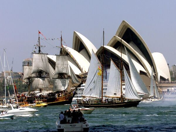 Tall ships Bounty (L) and Solway Lass (R) finish the Australia Day Tall ships race in Sydney 26 January 2001