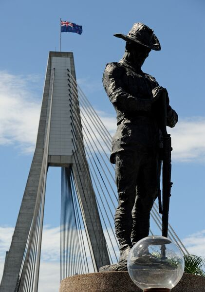 A bronze statue of an Australian First World War digger (R) bowed in silent reflection stands at one end of the Anzac Bridge in Sydney, the longest concrete cable-stayed span bridge in Australia. The flag flying on the bridge is the Australian national flag