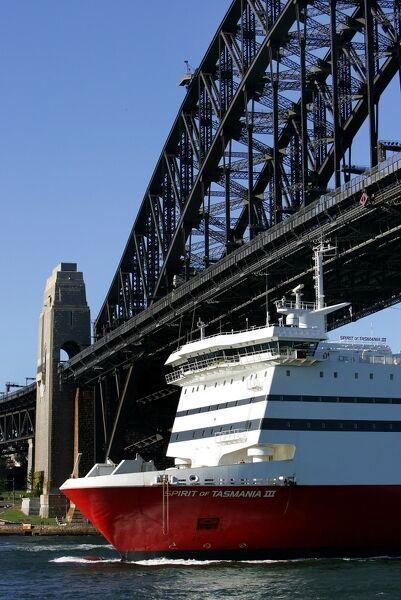 The Spirit of Tasmania III, a German built 174-metre long, 23,663-tonne ocean going passenger and car ferry, moves under the Sydney Harbour bridge, 10 April 2005, on the return leg of one of its trips between Sydney and Tasmania, Australia's only island state