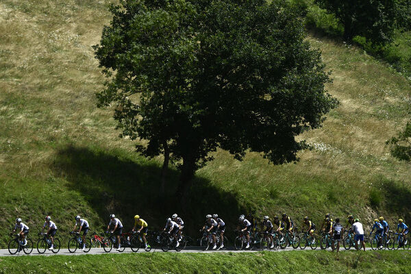 The pack, with Great Britain's Geraint Thomas (5thL), wearing the overall leader's yellow jersey, rides in the ascent of the Col d'Aspin pass during the 19th stage of the 105th edition of the Tour de France cycling race, on July 27