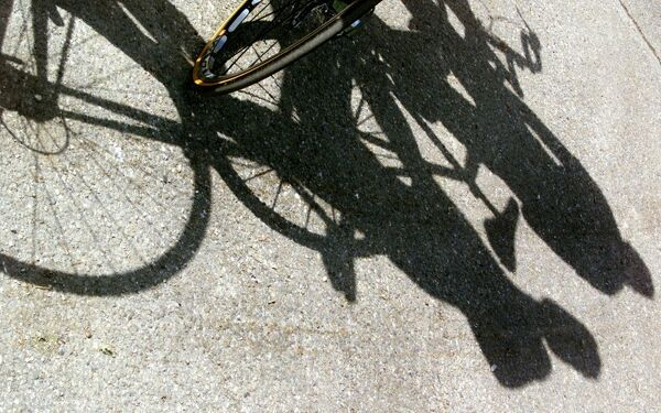 the shadows of riders appear on the ground before the beginning of the 10th stage of the 88th Tour de France in Aix-les-Bains 17 July 2001. AFP PHOTO JOEL SAGET / AFP PHOTO / JOEL SAGET