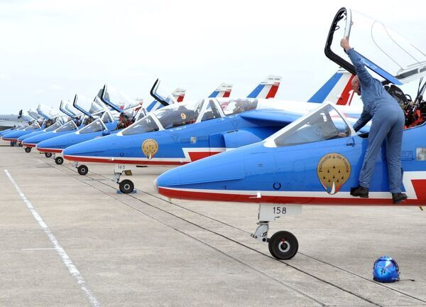 "French ""Patrouille de France"" (PAF) Alpha Jets planes are on the tarmac after the landing of the team on June 20, 2009 at the Bourget airport prior to the acrobatic team flying display at the 48th international Paris Air Show"