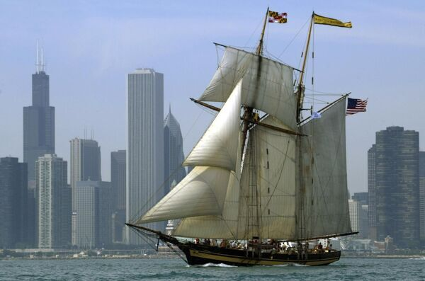 "The ""Pride of Baltimore II"" sails past the Chicago skyline 30 July, 2003 as the city of Chicago hosts the largest ""Tall Ship"" festival ever in the Great Lakes"