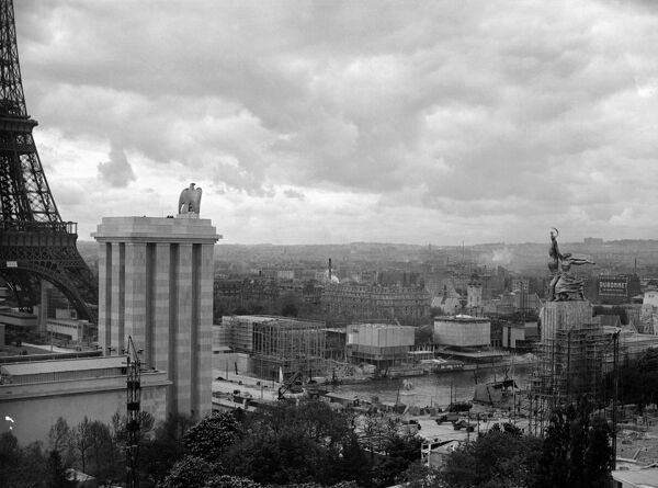 "A picture taken in June 1937 shows a general view of the Paris 1937 World Fair with the pavilion of the USSR topped by Soviet sculptress Vera Mukhina's stainless steel monumental sculpture 'Rabochy i Kolhoznitsa' (""The Worker and Collective-Farm"