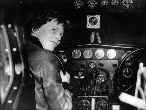 Amelia Earhart at the controls of her plane