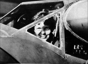 Amelia Earhart looking through the cockpit window