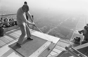 American Golfer Arnold Palmer kicks off from the second floor of the Eiffel Tower