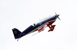 Fighter pilot and aerobatic, Captain Pierre Varloteaux performs in his Extra 330