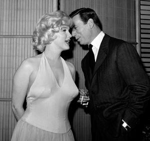 French Actor and Singer Yves Montand Whispers to Marilyn Monroe