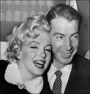 Marilyn Monroe with Joe DiMaggio during their wedding ceremony