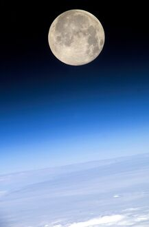 Full Moon; view above Earth's horizon and airglow