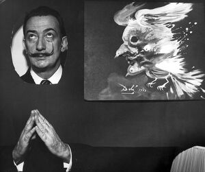 Salvador Dali Poses next to his masterpiece