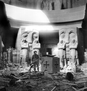 US soldier stands in the middle of rubble in the Monument of the Battle of the Nations