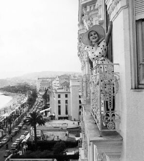 Zsa Zsa Gabor poses from the window of her apartment