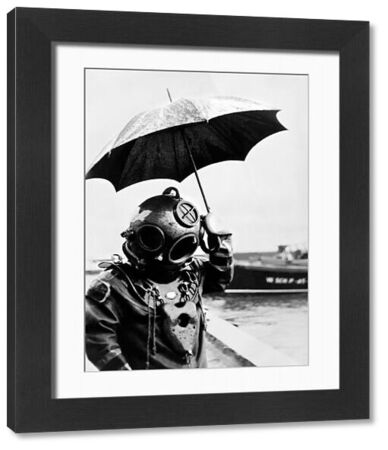 Picture dated 1949 of scuba diver with an umbrella. In 1943, Captain Jacques-Yves Cousteau invents, with Emile Gagnan, the first commercially successful open circuit type of Scuba diving equipment, the aqualung. / AFP PHOTO /