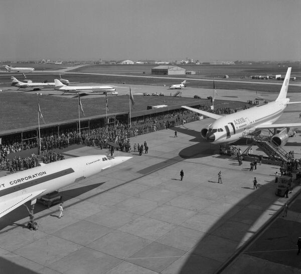 French-British supersonic jet-liner Concorde 002 (L) and the first Airbus A300 airliner sit on the tarmac during a presentation, 01 September 1972 in Toulouse