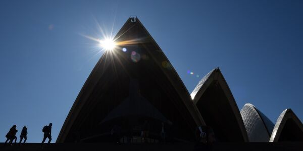Australia-Lifestyle. People visit the iconic Sydney Opera House on a winters day