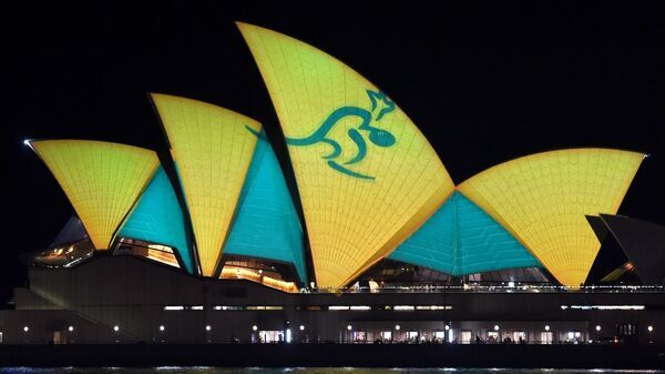 The Sydney Opera House is lit up in Australian colours on October 30, 2015, to support the Australian Wallabies rugby union team who take on the New Zealand All Blacks in the final of the Rugby World Cup on October 31 at Twickenham in London