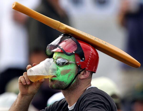An Australian fan sports an unusual hat as he drinks a beer and watches play on day two of the second cricket Test between Australia and Sri Lanka in Cairns, 10 July 2004. Australia are 7 for 474 at lunch. AFP PHOTO/Greg WOOD / AFP PHOTO / GREG WOOD