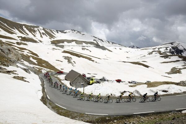 Cycling-Italy-Giro. The peloton rides at the La Bonette pass