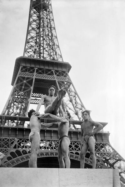 Young people practice gymnastics near the Eiffel Tower, in July 1945 in Paris. (Photo by - / AFP)