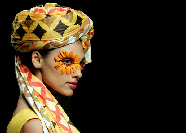 A model during the Lakme Indian Fashion Week (LIFW) in Mumbai. Colourful head wrap and decorated face paint. AFP PHOTO/Sajjad HUSSAIN (Photo by SAJJAD HUSSAIN / AFP)