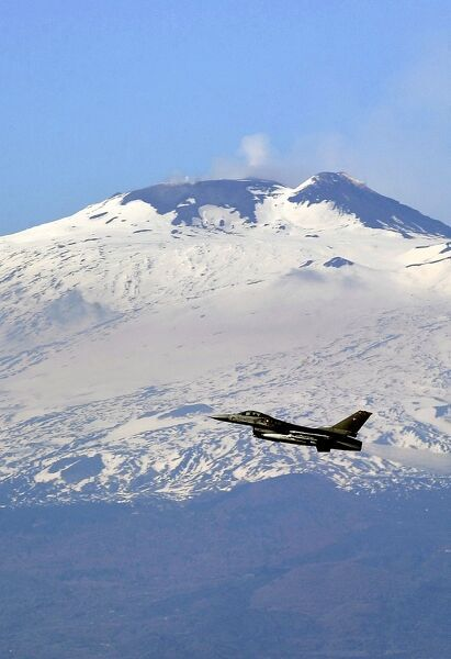 One of the six F16 fighter planes from Denmark air force based at the Italian military airport of Sigonella, southern Italy takes off in front of the Vulcano Etna at the base. AFP PHOTO / Filippo MONTEFORTE / AFP PHOTO / FILIPPO MONTEFORTE