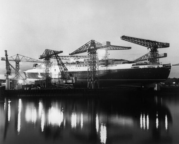 "General view dated 19 September 1967 of the British ocean liner ""Queen Elizabeth II"" in the John Brown Shipyard in Clydebank, Scotland. The ""Queen Elizabeth II"" was built by the Upper Clyde Shipbuilders and christened"