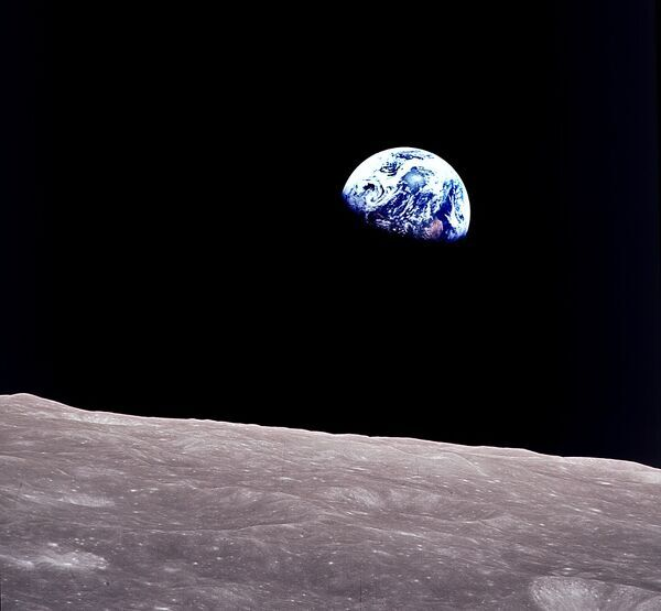 Rising Earth about five degrees above the lunar horizon