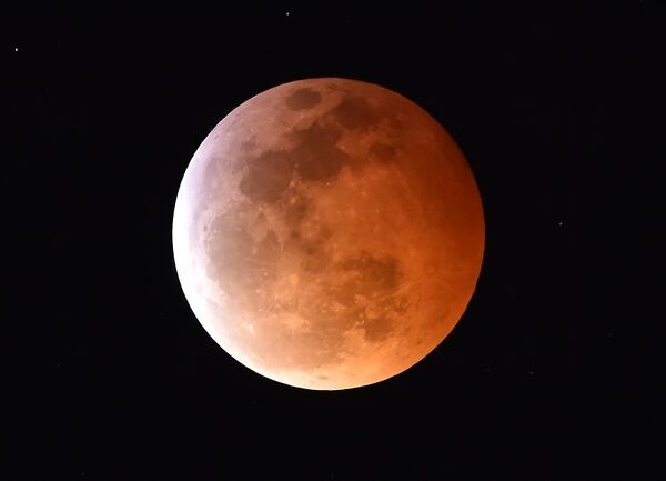 Super 'Blood Moon'. A Super Blood Moon is seen during a total lunar eclipse in Los Angeles