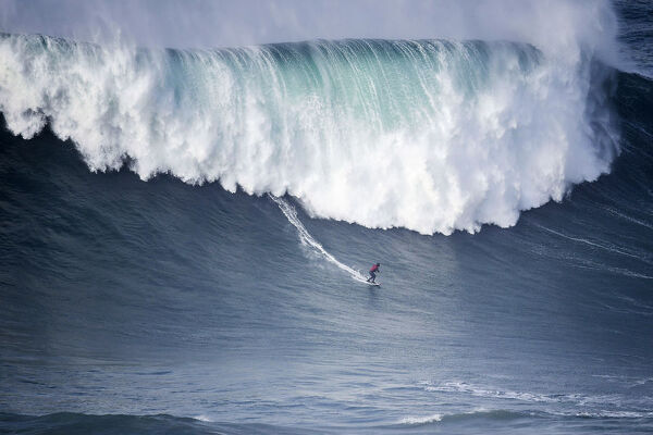 Surf-Portugal. Brazilian surfer Marcelo Luna rides a wave during the first