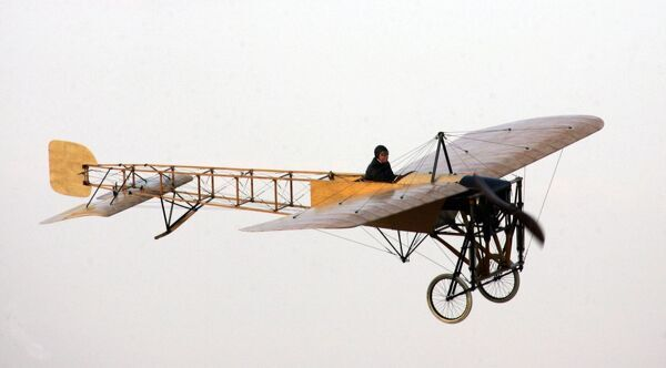 Uae-Aerobatics-Show. The world's oldest plane Bleriot XI flies during the