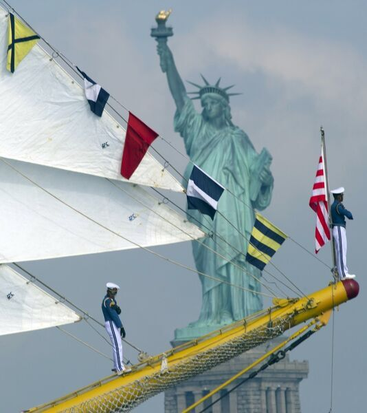 "Sailors aboard the tall ship from Indonesia ""Dewaruci"" sail past the Statute of Liberty May 23, 2012 in New York. The tall ship is participating in Fleet Week events in New York. AFP PHOTO/DON EMMERT / AFP PHOTO / DON EMMERT"