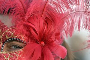 A costumed reveller poses on Saint Mark's square during the carnival on February 21