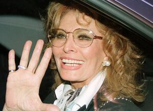 (FILES) -- This file picture shows Italian actress Sophia Loren waving to fans upon