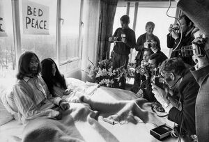 John Lennon and his wife Yoko Ono Receiving Journalists