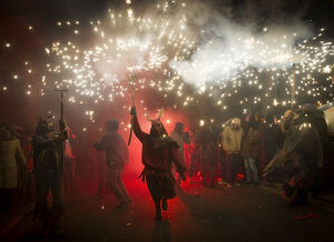 A reveller wearing a demon costume takes part in the traditional festival of