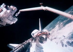 SPACE-SHUTTLE AND ROBOT ARM
