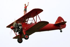 A wing-walker prerforms on a Boeing Stearman Pt13 during the WAG 2009 (World Air